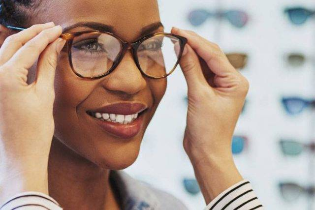 african american woman trying on eyeglasses